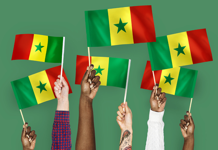 Hands waving the flags of Senegal