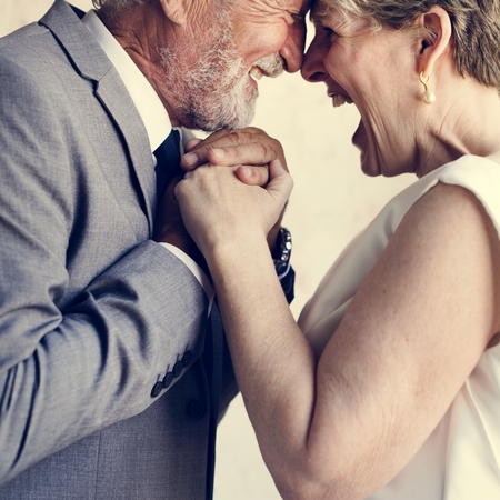 Senior Couple Holding Hands Together Cheerful Stock Photo - 104460181