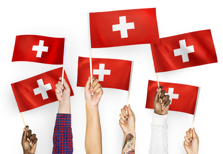 Hands waving the flags of Switzerland Banque d'images - 104460201