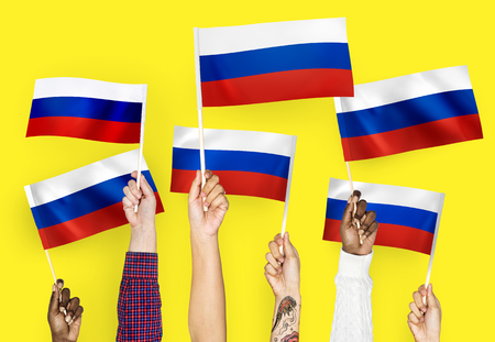 Hands waving the flags of Russia