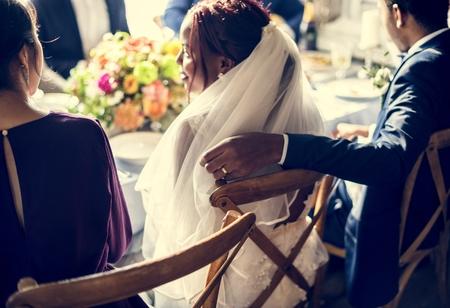 Groom Hand on Bride Chair Wedding Reception Stock Photo - 104460833