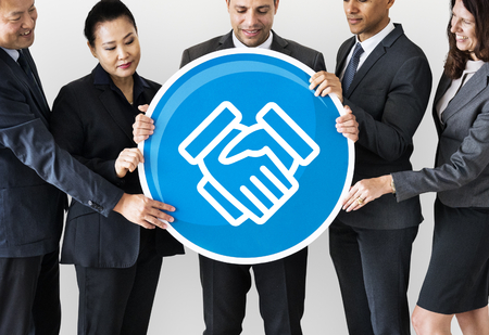 Business people holding a handshake icon