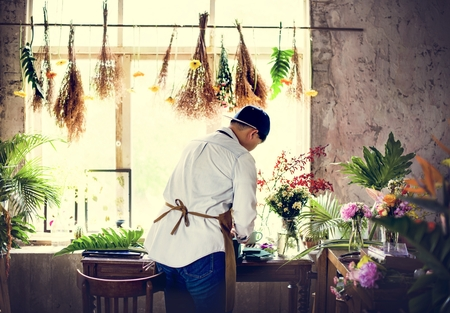 Flower shop business owner working service 写真素材