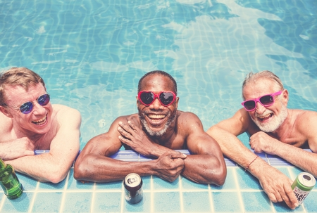Group of diverse senior men enjoying the pool together