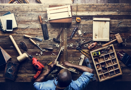 Aerial view of carpenter man working with tools equipment set Banque d'images
