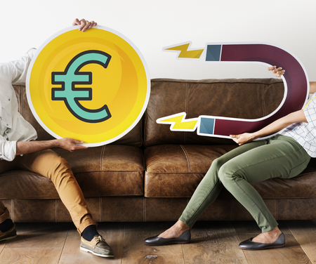 People holding financial icon and a magnet Banco de Imagens
