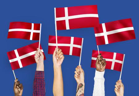 Hands waving the flags of Denmark Stock fotó