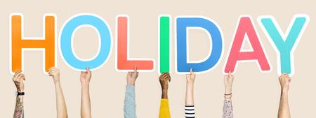 Diverse hands holding the word holiday Reklamní fotografie