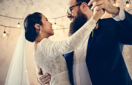 Newlywed Couple Dancing Wedding Celebration Stock Photo - 104675384