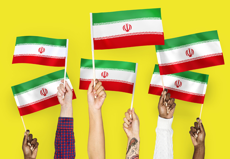 Hands waving the flags of Iran 版權商用圖片