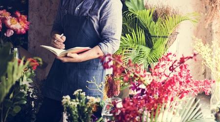 Flowerist working in the flower shop vintage style