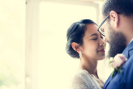 Closeup of Bride and Groom Staning Together Love Stock Photo