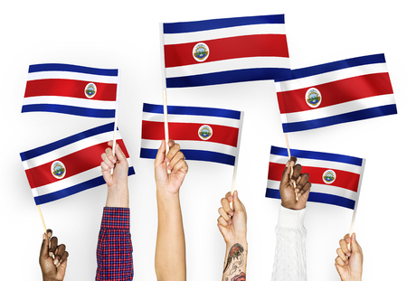 Hands waving the flags of Costa Rica 版權商用圖片