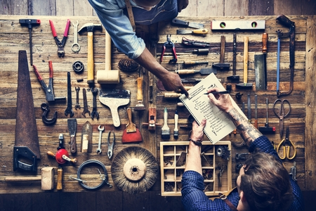 Aerial view of carpenter man listing checking tools equipment Stock Photo
