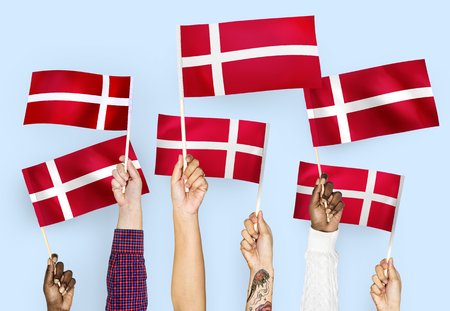 Hands waving the flags of Denmark Banco de Imagens