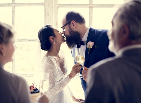Bride Kissing Groom Wedding Reception Stock Photo