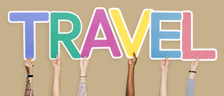 Diverse hands holding the word travel