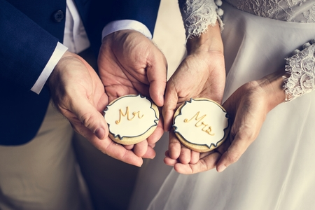 Newlywed Couple Hands Holding Showing Cookies Wedding Celebration