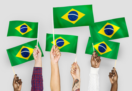 Hands waving the flags of Brazil