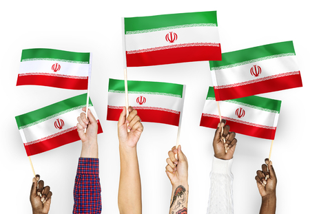 Hands waving the flags of Iran 写真素材