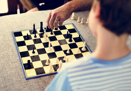 Rear view of young caucasian boy with chess boardgame Stock Photo