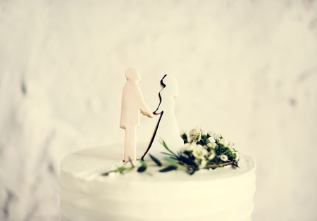 Closeup of groom and bride wedding cake topper Stock Photo