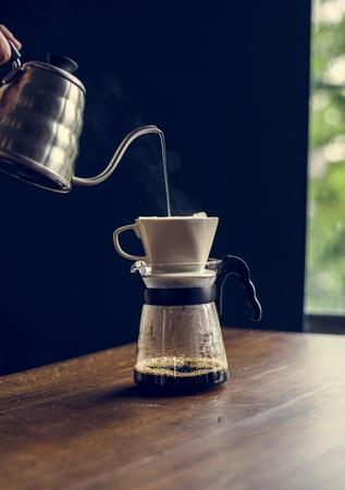 Barista hand dripping brewed coffee