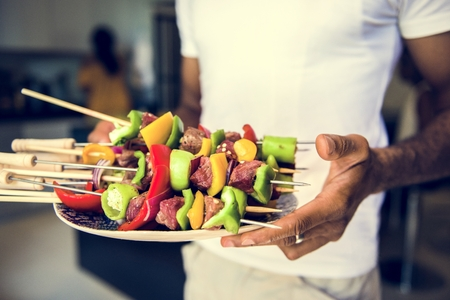 African descent man with homemade prepared barbecue