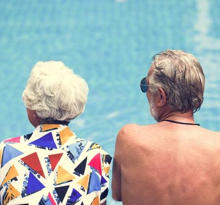 Senior couple sitting by the pool Reklamní fotografie