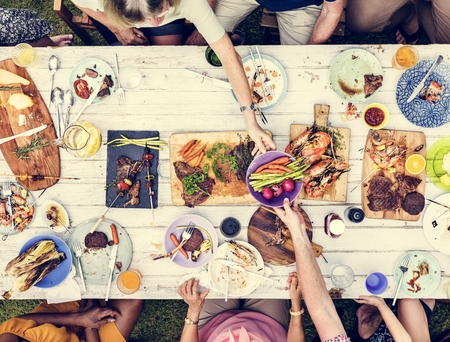 Aerial view of hands sharing food together