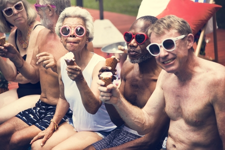Group of diverse senior adults eating ice cream together