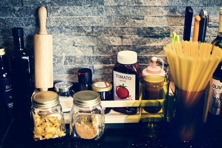 Kitchen condiments and objects on counter top