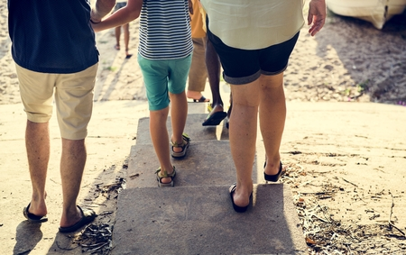 Rear view of caucasian family walking to the beach together