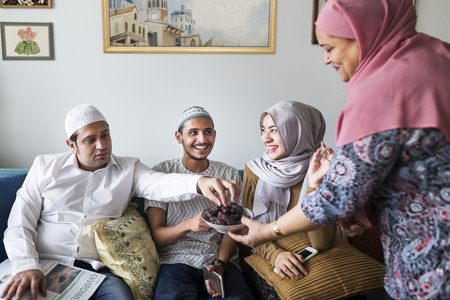 Muslim family having dried dates as a snack Stock Photo - 105390461