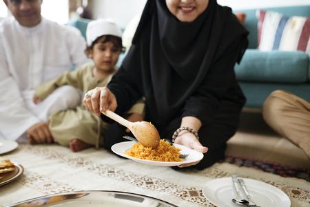 Muslim family having dinner on the floor Reklamní fotografie