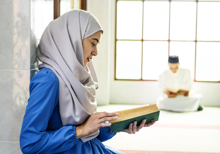 Muslims reading from the quran Stock Photo - 105391397
