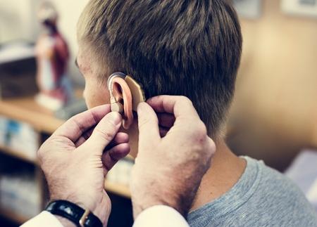 A man having his ears checked