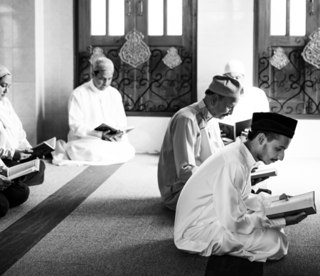 Muslims reading from the quran Stock Photo - 105391831