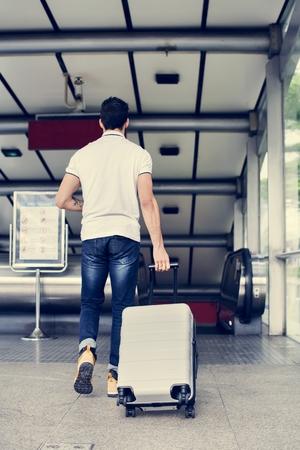 White man carrying luggage Stock Photo - 105391987