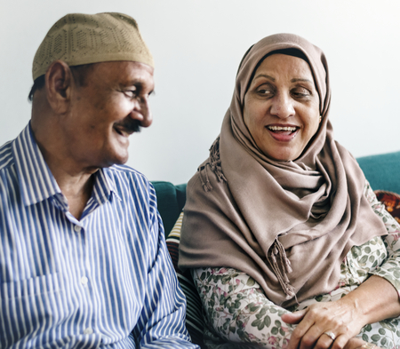 Mature Muslim couple at home Stock Photo - 105392003