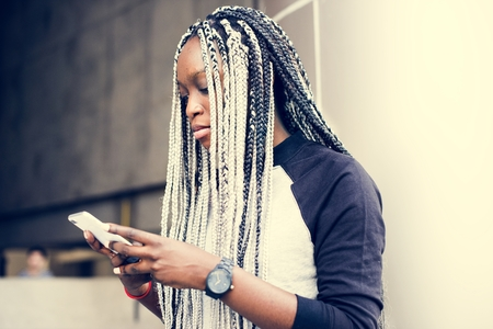 African woman using smartphone Stock Photo - 105392031