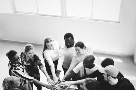 Diversity teamwork with joined hands Standard-Bild
