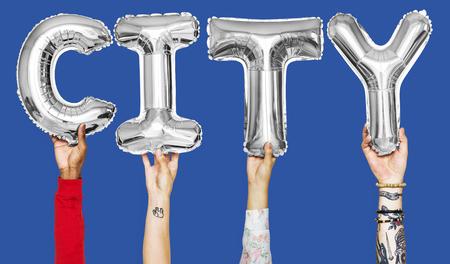 Hands showing city balloons word Archivio Fotografico - 105392243