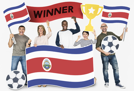 Diverse football fans holding the flag of Costa Rica 스톡 콘텐츠 - 105410395