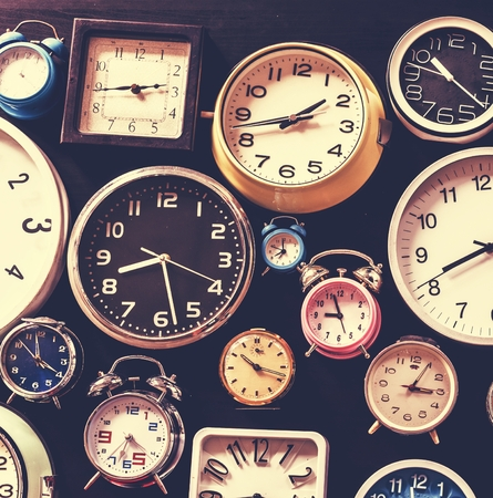 Closeup of various clocks isolated on black Banco de Imagens