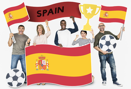Diverse football fans holding the flag of Spain
