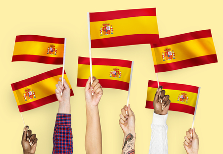 Hands waving the flags of Spain 版權商用圖片