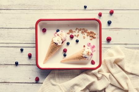 Berry ice cream in waffle cones Stock Photo