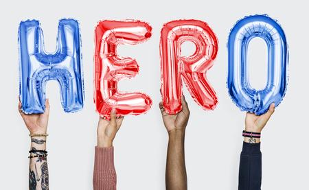 Hands showing hero balloons word