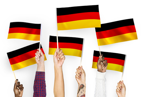 Hands waving the flags of Germany
